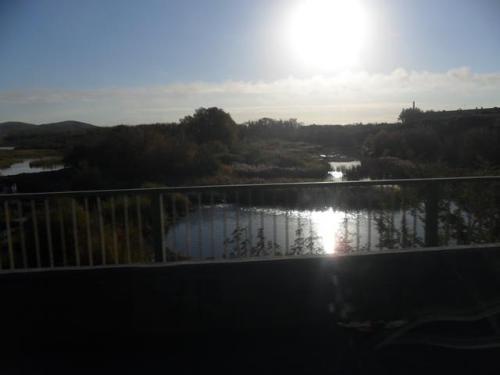 Солнце за мостом